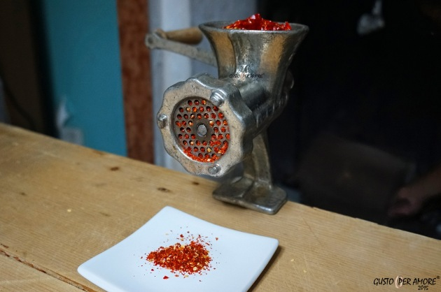 Meat mincer to grind dried hot chili pepper.